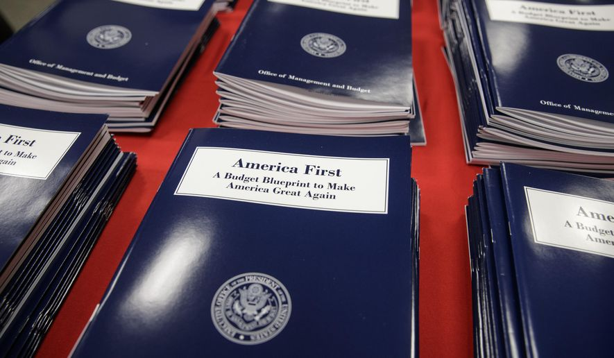 Copies of President Donald Trump's first budget are displayed at the Government Printing Office in Washington, Thursday, March, 16, 2017. Trump unveiled a $1.15 trillion budget on Thursday, a far-reaching overhaul of federal government spending that slashes many domestic programs to finance a significant increase in the military and make a down payment on a U.S.-Mexico border wall.   (AP Photo/J. Scott Applewhite)