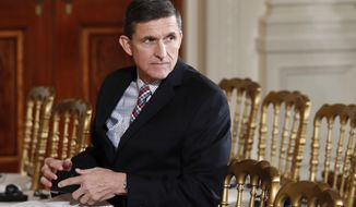 In this Feb. 10, 2017, file photo, then-National Security Adviser Michael Flynn sits in the East Room of the White House in Washington. Documents released in a congressional inquiry show Flynn was paid more than $33,750 by RT, Russia's government-run television system, for appearing at a Moscow event in December 2015. Flynn had retired months earlier as head of the U.S. Defense Intelligence Agency. (AP Photo/Carolyn Kaster, File)