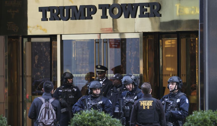 """In this Nov. 17, 2016 file photo, security personnel stand at the front entrance of Trump Tower in New York. There is no indication that Trump Tower was """"the subject of surveillance"""" by the U.S. government before or after the 2016 election, the top two members of the Senate intelligence committee said Thursday, March 16, 2017, directly contradicting President Donald Trump's claims.""""Based on the information available to us, we see no indications that Trump Tower was the subject of surveillance by any element of the United States government either before or after Election Day 2016,"""" Sens. Richard Burr, R-N.C. and Mark Warner, D-Va., said in a one-sentence joint statement Thursday afternoon. (AP Photo/Seth Wenig, File)"""