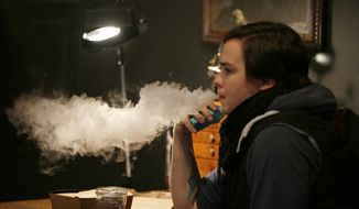 Teenagers who used e-cigarettes with higher concentration levels of nicotine were more likely to report an increased frequency of vaping and greater levels of smoking cigarettes, a study found. (Associated Press/File)