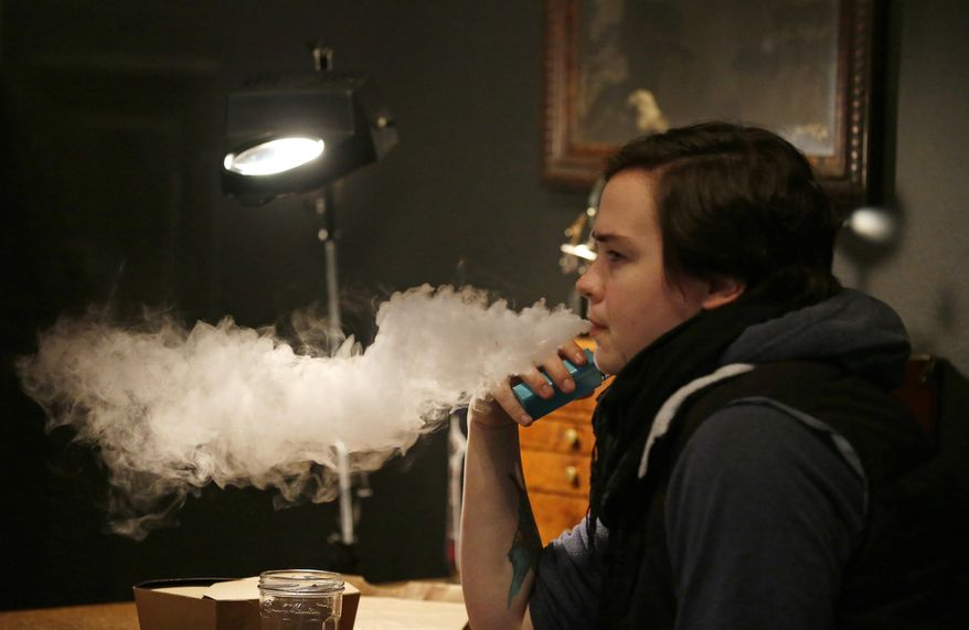 JUULing sends a rush of nicotine into the system from the company's unique liquid formula. (Associated Press/File)