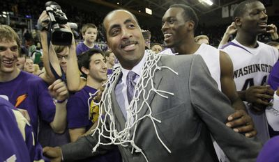 FILE - In this March 7, 2009 file photo, Washington coach Lorenzo Romar wears the net after he cut it from the rim as he celebrates with his team after Washington defeated Washington State 67-60 in an NCAA college basketball game to win the Pac-10 championship in Seattle. Washington announced Wednesday, March 15, 2017, that Romar had been fired after 15 seasons at the school. (AP Photo/Ted S. Warren, file)