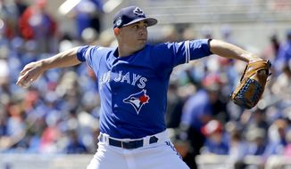 Toronto Blue Jays starting pitcher Aaron Sanchez throws in the first inning of a spring training baseball game against the New York Yankees, Thursday, March 16, 2017, in Dunedin, Fla. (AP Photo/John Raoux)