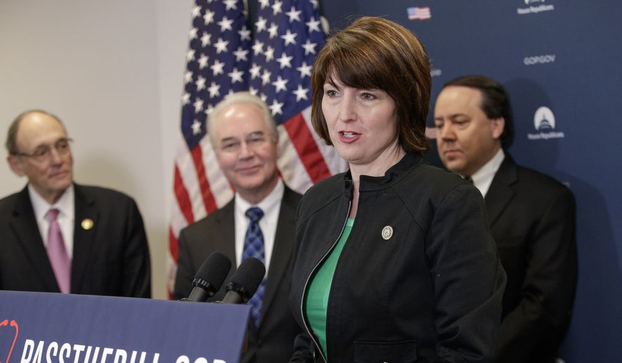 """Rep. Cathy McMorris Rodgers, R-Wash., chair of the Republican Conference, center, joined by, from left, Rep. Phil Roe, R-Tenn., Health and Human Services Secretary Tom Price, and Rep. Pat Tiberi, R-Ohio, speaks during a news conference on Capitol Hill in Washington, Friday, March 17, 2017, as House Republicans push for unity in advancing the GOP's """"Obamacare"""" replacement bill. (AP Photo/J. Scott Applewhite)"""