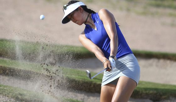 Michelle Wie blasts out of a bunker on the 15th hole during the second round of the Bank of Hope Founders Cup golf tournament Friday, March 17, 2017, in Phoenix. (Rob Schumacher/The Arizona Republic via AP)