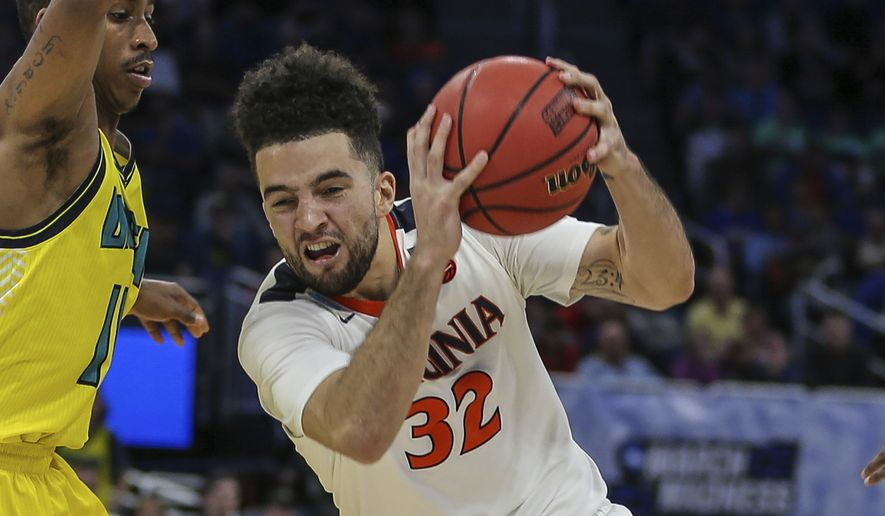 Virginia guard London Perrantes (32) drives to the basket during the second half of the first round of the NCAA college basketball tournament, Thursday, March 16, 2017 in Orlando, Fla. (AP Photo/Gary McCullough) **FILE**