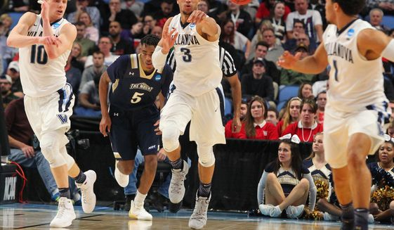 Villanova guard Josh Hart (3) passes the ball to guard Jalen Brunson (1) during the second half of a first-round men's college basketball game against Mount St. Mary's in the NCAA Tournament, Thursday, March 16, 2017, in Buffalo, N.Y. (AP Photo/Bill Wippert)