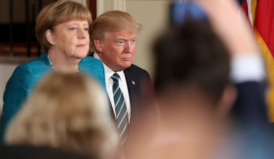 President Donald Trump and German Chancellor Angela Merkel arrive for a joint news conference in the East Room of the White House in Washington, Friday, March 17, 2017. (AP Photo/Andrew Harnik)