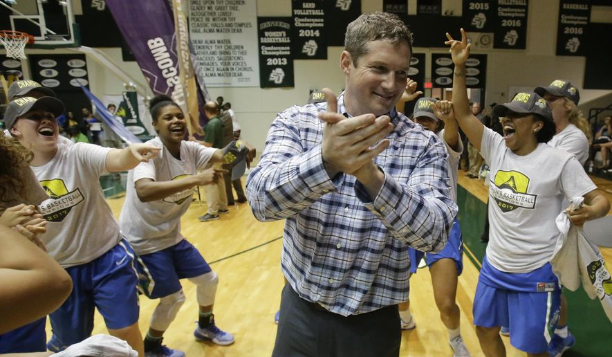 Florida Gulf Coast head coach Karl Smesko celebrates with his players after the team defeated Stetson in an NCAA college basketball game for the Atlantic Sun tournament title Sunday, March 12, 2017, in DeLand, Fla. (AP Photo/John Raoux)