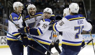 St. Louis Blues' Scottie Upshall (10) celebrates his goal with teammates Ryan Reaves (75) Alex Pietrangelo, second from left,, and Jay Bouwmeester during the first period of an NHL hockey game against the San Jose Sharks Thursday, March 16, 2017, in San Jose, Calif. (AP Photo/Marcio Jose Sanchez)