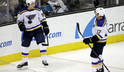 St. Louis Blues' Vladimir Tarasenko, left, celebrates his goal with teammate Jaden Schwartz (17) during the third period of an NHL hockey game against the San Jose Sharks on Thursday, March 16, 2017, in San Jose, Calif. (AP Photo/Marcio Jose Sanchez)