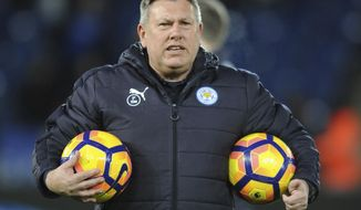 FILE- In this Monday, Feb. 27, 2017 file photo, Leicester caretaker manager Craig Shakespeare during the English Premier League soccer match between Leicester City and Liverpool at the King Power Stadium in Leicester, England. Craig Shakespeare will remain in charge of Leicester until the end of the season. He has the task of keeping the ailing champions in the Premier League following Claudio Ranieri's firing. (AP Photo/Rui Vieira, File)