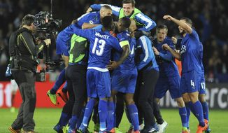 Leicester's players celebrate after the Champions League round of 16 second leg soccer match between Leicester City and Sevilla at the King Power Stadium in Leicester, England, Tuesday, March 14, 2017. Leicester win 3-2 on aggregate. (AP Photo/Rui Vieira)