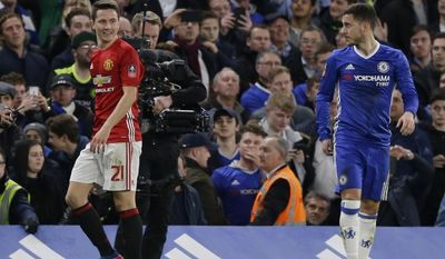 Manchester United's Ander Herrera, left, leaves the field after he was sent off during the English FA Cup quarterfinal soccer match between Chelsea and Manchester United at Stamford Bridge stadium in London, Monday, March 13, 2017 (AP Photo/Alastair Grant)