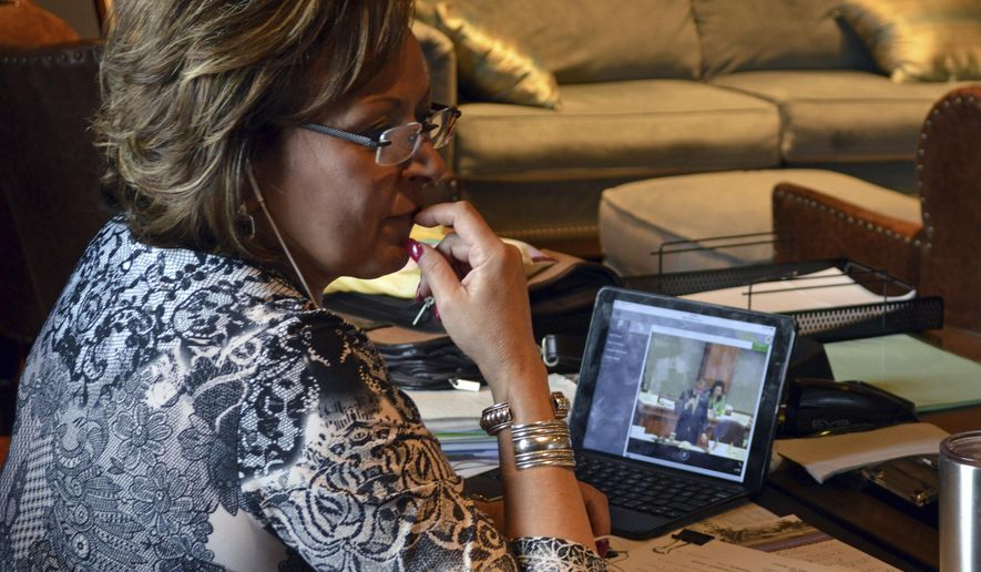 Republican New Mexico Gov. Susana Martinez watches a live stream of the Democratic-controlled New Mexico Legislature on Friday, March 17, 2017, in Albuquerque, N.M. A party-line vote in the Democrat-led House of Representatives set up a showdown with Martinez, who has pledged not to raise taxes while pushing for more belt-tightening. Martinez can veto all or portions of the budget and taxation bills. (AP Photo/Russell Contreras)