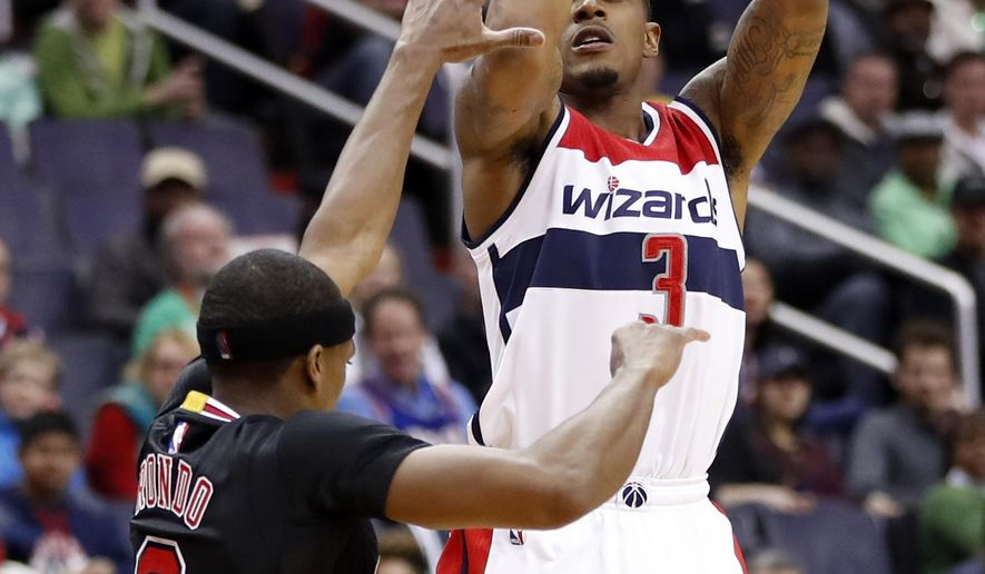 Washington Wizards guard Bradley Beal (3) shoots over Chicago Bulls guard Rajon Rondo (9) during the first half of an NBA basketball game Friday, March 17, 2017, in Washington. (AP Photo/Alex Brandon)