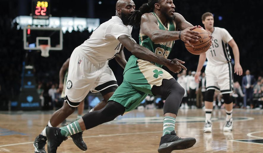 Boston Celtics forward Jae Crowder (99) drives past Brooklyn Nets forward Quincy Acy (13) during the fourth quarter of an NBA basketball game, Friday, March 17, 2017, in New York. The Celtics won 98-95. (AP Photo/Julie Jacobson)
