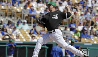 Chicago White Sox's Derek Holland throws during the first inning of a spring training baseball game against the Chicago Cubs, Friday, March 17, 2017, in Phoenix. (AP Photo/Darron Cummings)