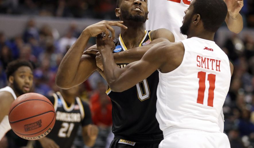 Wichita State's Rashard Kelly, left, has the ball knocked away by Dayton's Scoochie Smith during the first half of a first-round game in the men's NCAA college basketball tournament Friday, March 17, 2017, in Indianapolis. (AP Photo/Jeff Roberson)