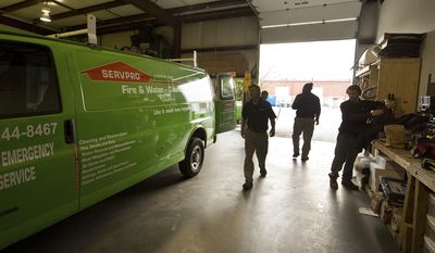 ADVANCE FOR SUNDAY MARCH 19 AND THEREAFTER - In a March, 6, 2017 photo, Servpro of Newport News crew members prepare to leave for a job in Virginia Beach, Va. Teams from the Newport News company clean up crime scenes and fires.  (Joe Fudge/The Daily Press via AP)