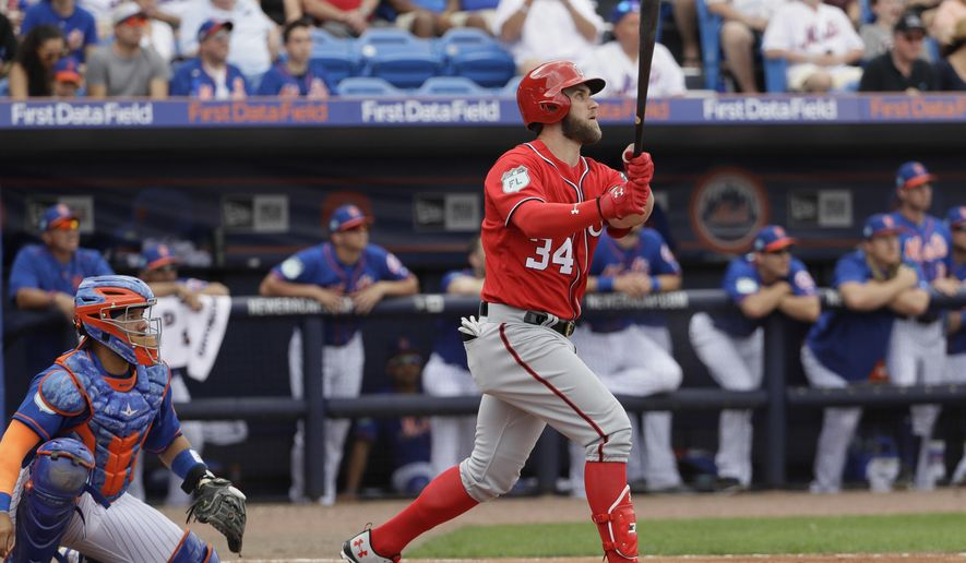 FILE - In this Feb. 25, 2017, file photo, Washington Nationals' Bryce Harper watches his home run against the New York Mets during a spring training baseball game in Port St. Lucie, Fla. There is a reason Harper continues to be a high first round pick despite disappointing fantasy team owners last year. It's his 2015 season. Harper batted .330 with 42 home runs, 118 runs and 99 RBIs. Harper saw a huge drop in average and hit only 24 homers last year, but he did steal 21 bases. This spring, Harper is tearing the cover off the ball, flashing that power again. While it would be surprising to see a .330 average and 40-plus home runs again, Harper is still just 24 years old. Hitting 30-plus home runs with a high-200s average and 20 steals is doable, and that would make Harper a top-5 hitter again. (AP Photo/David J. Phillip, File)