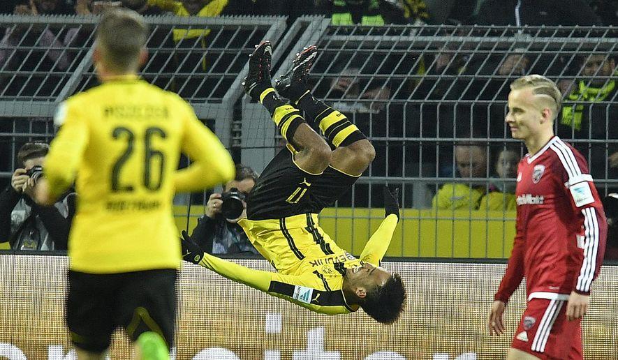 Dortmund's Pierre-Emerick Aubameyang jumps a salto after scoring the opening goal during the German Bundesliga soccer match between Borussia Dortmund and FC Ingolstadt in Dortmund, Friday, March 17, 2017. (AP Photo/Martin Meissner)