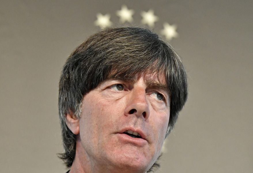 FILE - In this Aug. 29, 2016 file photo Germany's head coach Joachim Loew talks to the media under 4 stars at a press conference in Duesseldorf, Germany. Loew has called up Leipzig forward Timo Werner for the first time and World Cup winner Lukas Podolski for the last time for upcoming games against England and Azerbaijan. (AP Photo/Martin Meissner, file)