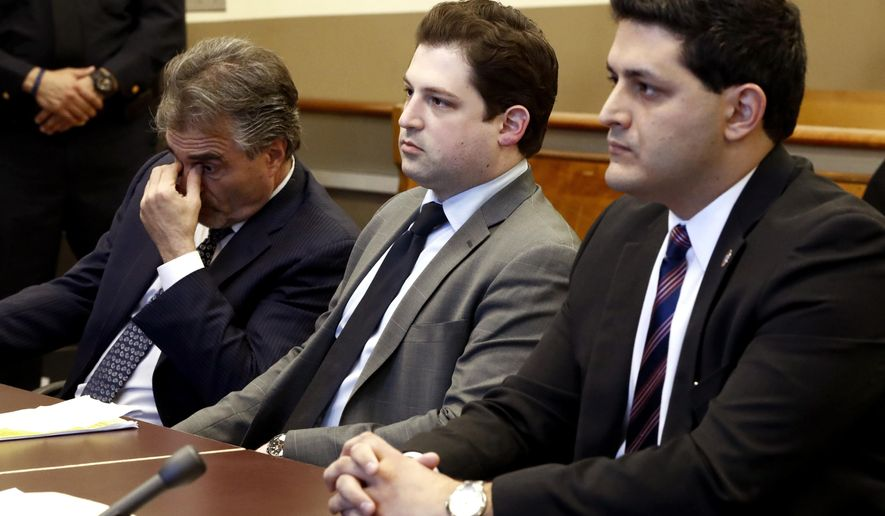 Max Nobel, center, attorney for John Cramsey, a Pennsylvania man arrested at the Holland Tunnel last year with a cache of weapons, sits with partner James Lisa, left, and Hudson County Assistant Prosecutor Tom Zuppa during a hearing for Cramsey, Friday, March 17, 2017, in Jersey City, N.J. Nobel appealed the denial of Cramsey's request to enter a pretrial intervention program that would allow him to avoid jail time. Judge Mitzy Galis-Mendez rejected their appeal. (AP Photo/Julio Cortez)