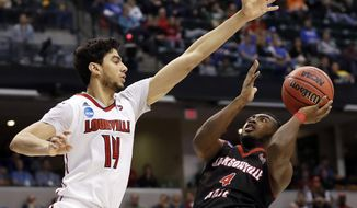 Jacksonville State's Tyrik Edwards (4) heads to the basket as Louisville's Anas Mahmoud (14) defends during the second half of a first-round game in the men's NCAA college basketball tournament Friday, March 17, 2017, in Indianapolis, Mo. Louisville won 78-63. (AP Photo/Jeff Roberson)