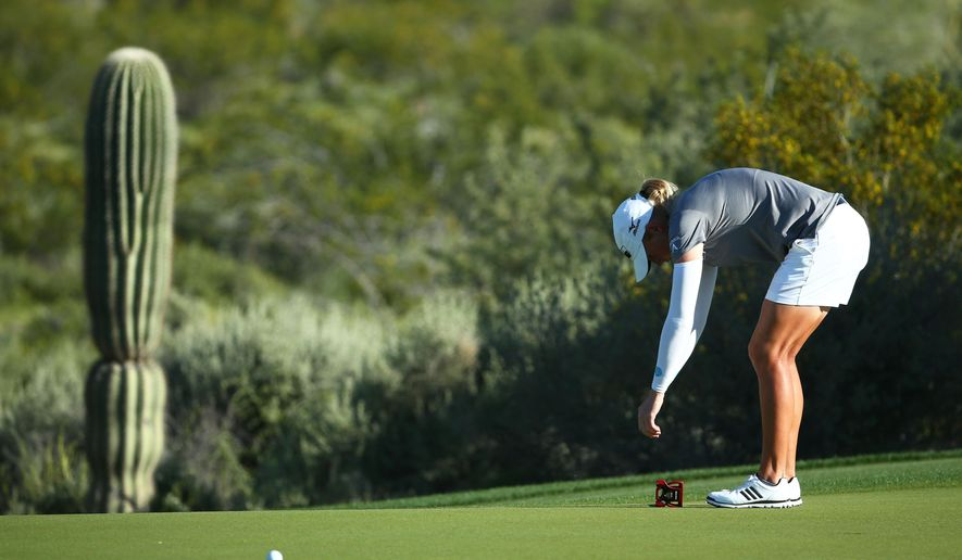 Stacy Lewis reacts after missing her birdie putt on the 15th green during the first round of the Bank of Hope Founders Cup golf tournament Thursday, March 16, 2017, in Phoenix. (Rob Schumacher/The Arizona Republic via AP)