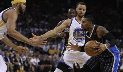 Orlando Magic's C.J. Watson, right, drives the ball against Golden State Warriors' Stephen Curry (30) and JaVale McGee, left, during the first half of an NBA basketball game Thursday, March 16, 2017, in Oakland, Calif. (AP Photo/Ben Margot)