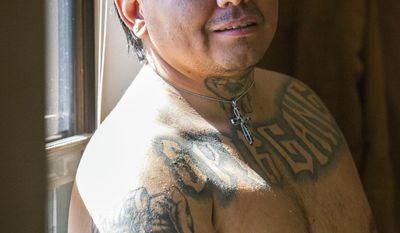 In this March 3, 2017 photo, David Montoya poses for a photo at his home in Cedar City, Utah. Montoya is a former convict who overcame his troubled past to become a current Mental Health Court participant. (Jordan Allred/The Spectrum via AP)