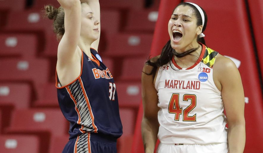 Maryland center Brionna Jones, right, reacts in front of Bucknell forward Catherine Romaine after being fouled while scoring in the first half of a first-round game in the women's NCAA college basketball tournament in College Park, Md., Friday, March 17, 2017. (AP Photo/Patrick Semansky)