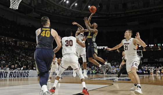 Marquette's Duane Wilson (1) shoots against South Carolina during the first half in a first-round game of the NCAA men's college basketball tournament in Greenville, S.C., Friday, March 17, 2017. (AP Photo/Rainier Ehrhardt)
