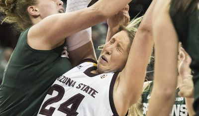 Arizona State forward Kelsey Moos (24) grabs a rebound against Michigan State center Jenna Allen, left, during a first-round game in the women's NCAA college basketball tournament Friday, March 17, 2017, in Columbia, S.C. (AP Photo/Sean Rayford)