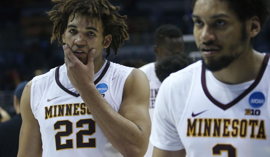 Minnesota's Reggie Lynch (22) walks off the court after an NCAA college basketball tournament first round game against Middle Tennessee State Thursday, March 16, 2017, in Milwaukee. Middle Tennessee State won 81-72. (AP Photo/Kiichiro Sato)
