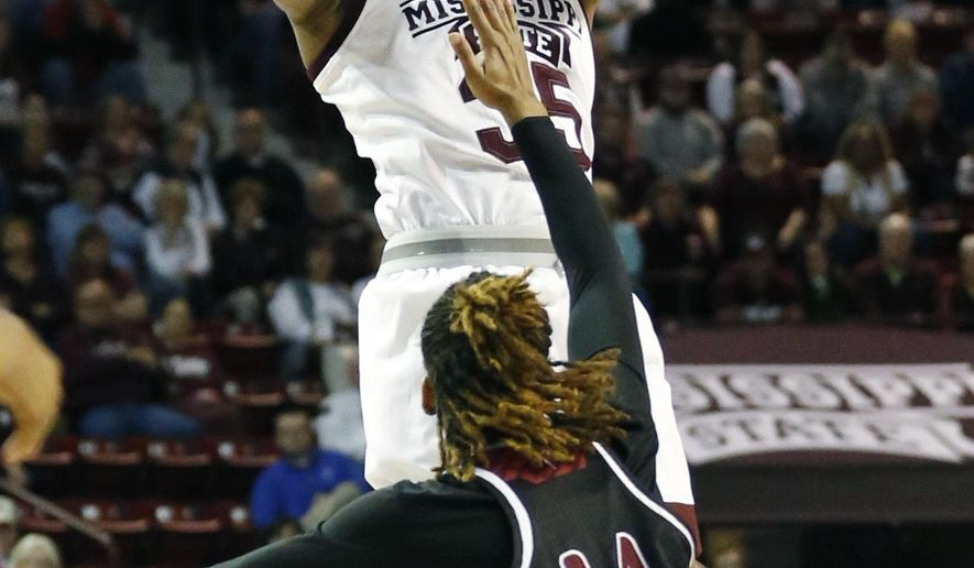 Mississippi State forward Victoria Vivians (35) shoots a long shot over Troy guard Claresa Banks (14) during the first half of a first-round game in the women's NCAA college basketball tournament in Starkville, Miss., Friday, March 17, 2017. (AP Photo/Rogelio V. Solis)