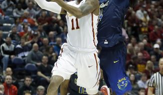 Iowa State's Monte Morris (11) goes up for a shot against Nevada's Lindsey Drew (14) during the first half of an NCAA college basketball tournament first-round game Thursday, March 16, 2017, in Milwaukee. (AP Photo/Kiichiro Sato)