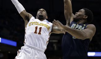 Iowa State's Monte Morris (11) shoots over Nevada's Cameron Oliver (0) during the second half of an NCAA college basketball tournament first-round game Thursday, March 16, 2017, in Milwaukee. (AP Photo/Morry Gash)