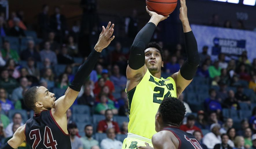 Baylor guard Ishmail Wainright (24) shoots between New Mexico State guard Matt Taylor (24) and forward Jemerrio Jones (10) in the first half of a first-round game in the men's NCAA college basketball tournament in Tulsa, Okla., Friday, March 17, 2017. (AP Photo/Sue Ogrocki)