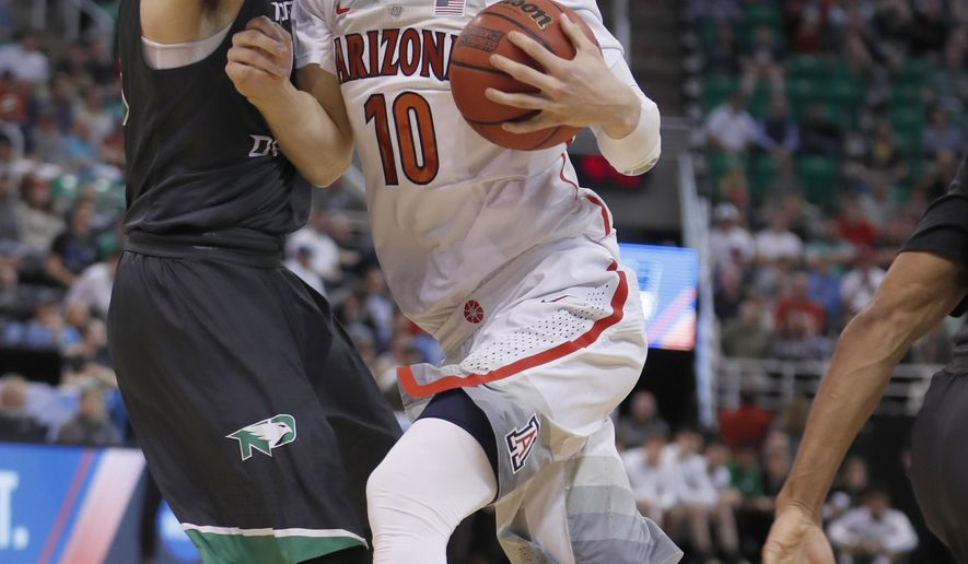 Arizona forward Lauri Markkanen (10) drives on North Dakota forward Drick Bernstine (43) during the second half of a first-round game in the NCAA men's college basketball tournament Thursday, March 16, 2017, in Salt Lake City. Arizona defeated North Dakota 100-82. (AP Photo/George Frey)