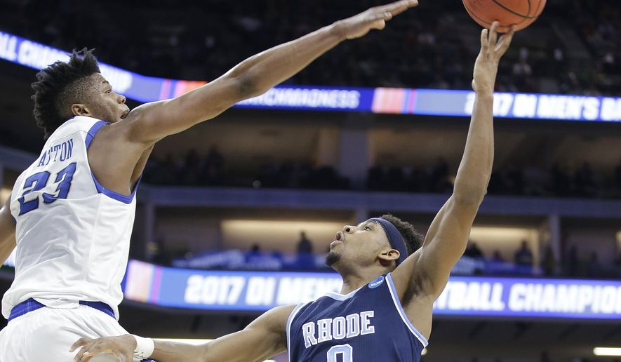 Rhode Island guard E.C. Matthews, right, shoots against Creighton center Justin Patton during the first half of a first-round game of the men's NCAA college basketball tournament Sacramento, Calif., Friday, March 17, 2017. (AP Photo/Rich Pedroncelli)