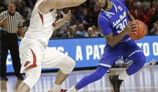 Seton Hall's Madison Jones (30) drives against Arkansas's Dusty Hannahs (3) during the second half in a first-round game of the NCAA men's college basketball tournament in Greenville, S.C., Friday, March 17, 2017. (AP Photo/Chuck Burton)