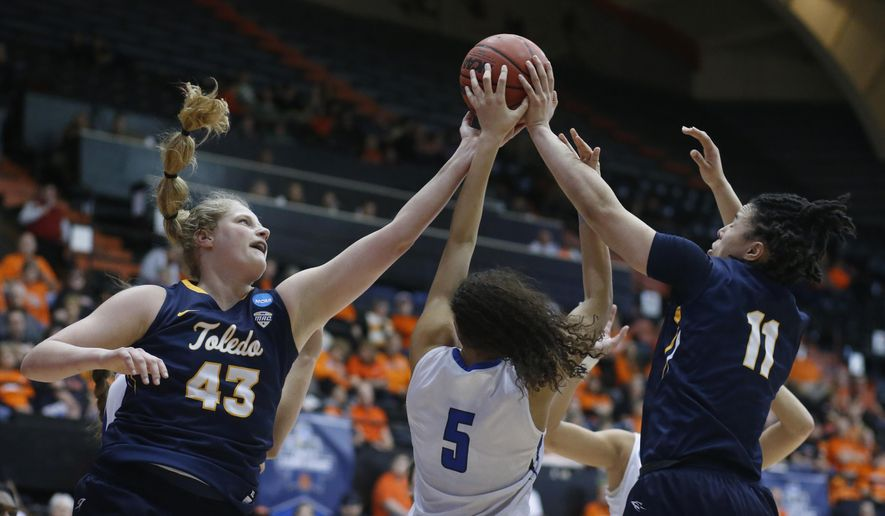 Toledo's Sophie Reecher (43), and Jay-Ann Bravo-Harriott (11) fight Creighton's Jaylyn Agnew (5) for a rebound during the first half of a first-round game in the women's NCAA college basketball tournament Friday, March 17, 2017, in Corvallis, Ore. (AP Photo/Timothy J. Gonzalez)