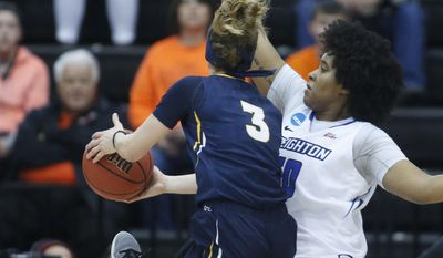 Toledo's Mariella Santucci (3) is stopped from getting to the basket by Creighton's Brianna Rollerson (50) during the first half of a first-round game in the women's NCAA college basketball tournament Friday, March 17, 2017, in Corvallis, Ore. (AP Photo/ Timothy J. Gonzalez)