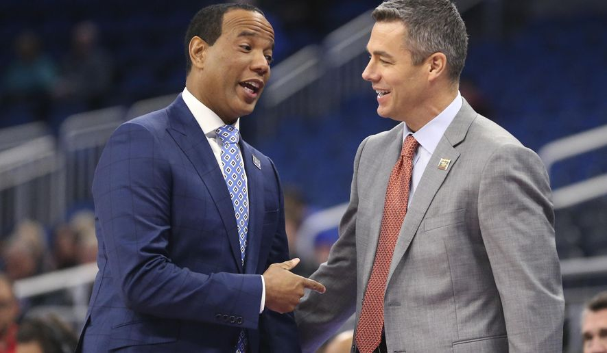 UNC Wilmington head coach Kevin Keatts, left, and Virginia head coach Tony Bennett greet each other before the start of a first-round men's college basketball game in the NCAA Tournament, Thursday, March 16, 2017, in Orlando, Fla. (AP Photo/Gary McCullough)