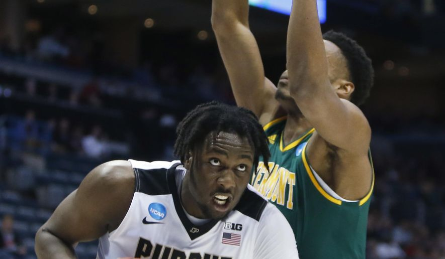 Purdue's Caleb Swanigan tries to drive past Vermont's Darren Payen during the first half of an NCAA college basketball tournament first round game Thursday, March 16, 2017, in Milwaukee. (AP Photo/Kiichiro Sato)
