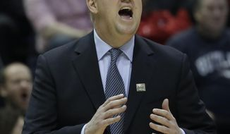 Purdue head coach Matt Painter yells during the first half of an NCAA college basketball tournament first round game against Vermont Thursday, March 16, 2017, in Milwaukee. (AP Photo/Morry Gash)