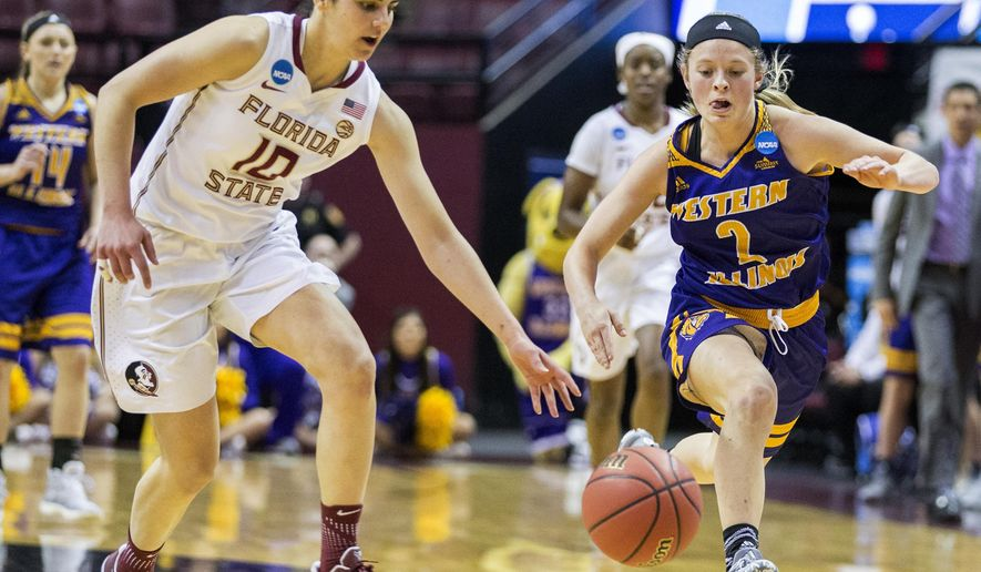 Florida State guard Leticia Romero and Western Illinois guard Emily Clemens race for a loose ball  during the first half of a first-round game in the NCAA women's college basketball tournament in Tallahassee, Fla., Friday March 17, 2017. (AP Photo/Mark Wallheiser)