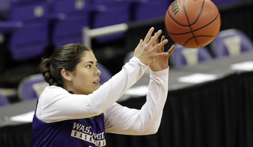 Washington's Kelsey Plum reaches for a passed ball at a practice a day before the team's first round NCAA tournament college basketball game Friday, March 17, 2017, in Seattle. Washington plays Montana State on Saturday. (AP Photo/Elaine Thompson)